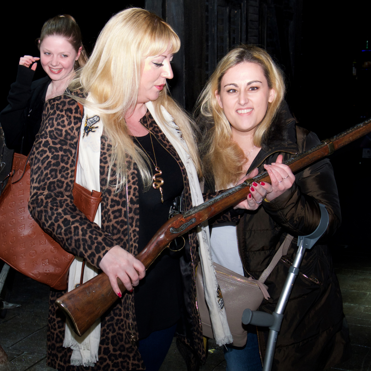 A Mum and her partially sighted daughter handle the muskets used in Les Miserables at a touch tour